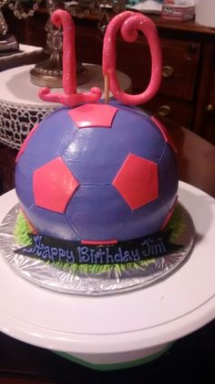 Girl's soccer ball cake we created for a 10th birthday. By the way, the purple is not fondant...