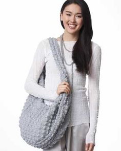 Cute bobble sac crochet.... i like, but it's too big.... wonder if I could figure out how to make it smaller