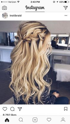 messy waterfall braid half-updo wavy