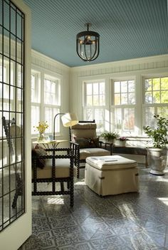 Beautiful sun porch with painted wood floors and blue slatted ceiling (oh yeah, and AMAZING windows)