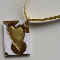 A pretty pendant with a cut-out heart motif. Backed by gold-coloured metal and topped off with soft pink and gold-coloured polka dots. A beautiful compliment to a wide array of styles. Beautiful Compliments, Pink And Gold, Arrow Necklace, Polka Dots, Pendants, Christmas Ornaments, Holiday Decor, Metal, Heart