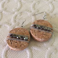 Wire wrapped cork earrings, upcycled wine cork, silver beaded earrings, eco friendly earrings, recycled materials, hipster jewelry, dangle by TelltaleTrinketShop on Etsy https://www.etsy.com/listing/384725122/wire-wrapped-cork-earrings-upcycled-wine