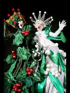 Holly & Mistletoe Stilt Walkers from www.FlamingFun.com Call 07788732552 for more info.