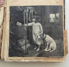 Vintage photo from the mid-1800s of a young girl and a pit bull