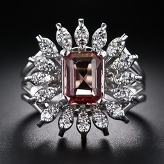 Imperial Topaz and Diamond Estate Cocktail Ring. An enchanting orange-pink emerald-cut natural topaz, weighing 1.50 carats, radiates from the center of sparkling white diamond petals in this dazzling and distinctive smile maker - circa mid-twentieth century. A Hawaiian sunset on your finger. Lang Antiques.