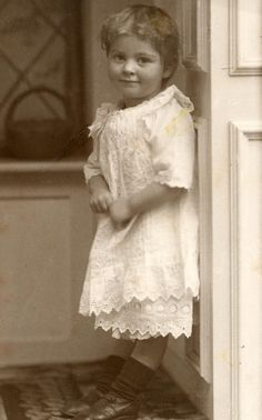 Wonderful antique photo of a little girl in a darling dress.    Love the beginnings of a smile!