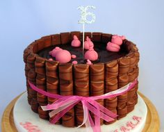 Piggy Mud Bath - using Kinder Bueno. Chocolate cake with chocolate butter icing and a dark chocolate ganache topping.