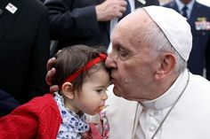 Pope Francis kisses