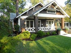 bungalow with dark brown siding and cream trim- I'd add some color in the window sashes and front door