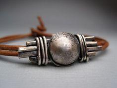 Shield bracelet by Lesley Tinnaro on etsy