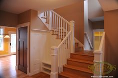 From the custom built shoes rack behind the banister to the staircase that allows access to the mud room, it's all custom!