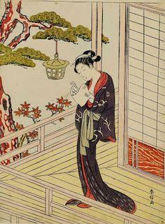 Harunobu, Suzuki (1725-1770) Young woman reading a letter by lamplight