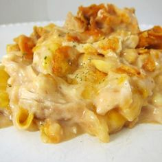 Dorito Chicken and Cheese Casserole  - made a similar recipe last night - mix 2-3 c. shredded chicken w/1 can cream of chicken soup, 1/2 c. milk, 1/2 c. sour cream, 2 c. cheese & 1/2 taco seasoning packet.  Crush Doritos & layer on bottom of casserole dish; add 1/2 chicken mixture; repeat; top w/cheese.  Bake 350, 30-35 mins.  Delicious!