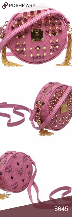 MCM Pink Visetos Crystal Tambourine Mini Crossbody MCM pink and gold tone hardware with decorative pink rhinestones and spikes, adjustable flat shoulder strap, metal tassel side details, a top zipper closure and interior lining is satin fabric. MCM Bags Crossbody Bags