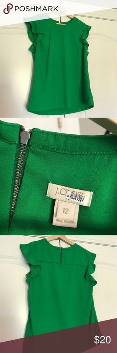 Green J.Crew Ruffle Top The prettiest shade of green, with great ruffle shoulder detail. Thick, quality fabric. Great piece. Smoke fee Home. Dry cleaned. Perfect condition. J. Crew Tops
