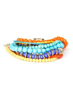 This festive set of stylish bracelets is all about the more-is-more philosophy. There's a treasure chest's worth of colorful baubles here, all delightful variations on the beaded bracelet. Piled together, they make for a knockout statement.