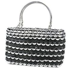 This stylish 9 by 5.5 inch soda top and tire bag has two solid handles. The bag features a zip closure with an internal zip pocket in the black lining. Meet the Artisans The founders of BIO Imaginarte