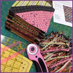 Squaring up the lattice quilt.  The tape on the ruler ensured that lattice strip was properly centered.