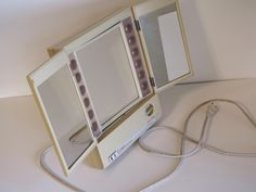 Vintage Clairol True-to-Light Electric Make-up Mirror - I had this exact one right up to the late 80s.