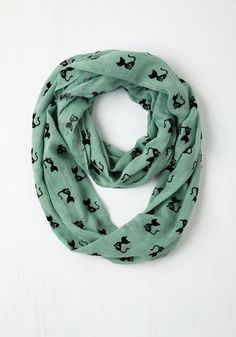 It's felines for you, all the way, and this mint, cat-print scarf shows your affection for your favorite four-legged friends! Covered with black cat silhouettes, this sheer wrap wis 'purr'-fect for curling up with a book at a cafe or prowling the city for vintage finds!