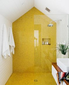 The eye-catching yellow gloss tiles in the main ensuite bathroom are from BetterTiles in Sydney. Story: real living #Yellow #modernfurniture2016