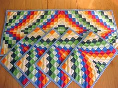 interesting BARGELLO pattern. table runner and place mats. cool!