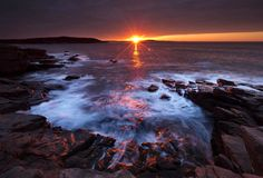 The sun's rays strike the rocky coast of Acadia National Park in Maine. A federal budget-related delay has pushed back the opening of many of the park's seasonal facilities until May Acadia National Park, National Park Tours, Go Camping, Outdoor Camping, Maine Usa, Costa, Most Visited National Parks, Park Service, Death Valley
