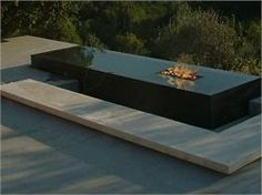 Raised pond with firepit