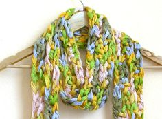"""Multi-color pastel scarf made using a soft bulky yarn and over-sized stitches for a unique and fashionable look for spring. A fun accessory for any wardrobe, the scarf measures approximately 70"""" long and 5"""" wide, plus 6 inches of fringe on each end. Hand wash in cold water and lay flat to dry.  Handmade item, in-stock, ships in 2-3 business days"""