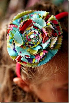 these are the same as the other circle flowers. Just cut out circles w pinking shears. fold in half and in half again. place the flowers together and (I sew them but you can hot glue as well) into place. add your finishing touches and attach to the headband of choice.