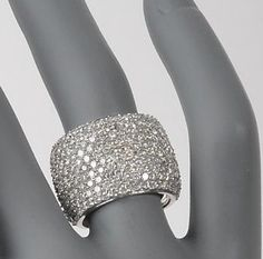 Obsessed...I wouldn't mind looking at this for the rest of my life..  4.00 ct. t.w. Diamond Ring In 14kt White Gold  A fabulous wide band ring amplifies the sparkle. Diamonds total four carats. Ring is set in 14kt white gold.  RS Value Price : $3,495.00  Retail: $9,995.00