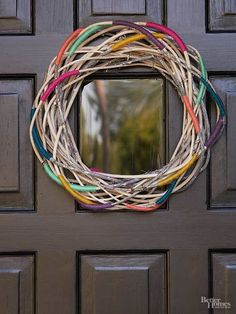 Add pops of color to a twisted twig wreath from a crafts store. Wrap medium-weight yarn tightly around twigs within the wreath, securing the ends with a clear-drying glue. Disperse colors throughout for a chic yet casual look. Twig Wreath, Front Door Decor, Home And Deco, Craft Stores, Curb Appeal, Diy And Crafts, Easy Crafts, Modern Crafts, Rock Crafts