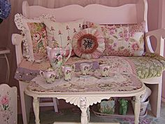 pretty cottage bench/pillows and broken china mosaic coffee table