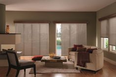 Sliding panels with wood valance and matching roller shade on side window