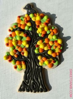 Crow in an October tree cookie made with our Partridge in a Pear Tree cookie cutter! Xo   http://sweetdanib.com/cookie-cutters/