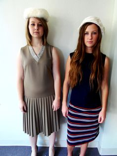 Brown pleated dress, navy/striped dress, white hats