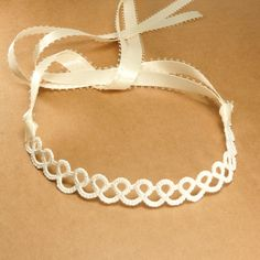 Dainty white tatted lace choker .... I would rather use this as a headband