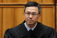 Judge Temporarily Halts New Version of Trumps Travel Ban