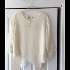 Beautiful asymmetric ivory top 🎉 HP🎉 100% rayon top asymmetric design. Made in India. Tag says one size. Approx 24 inches across from armpit across. Boutique Tops Blouses