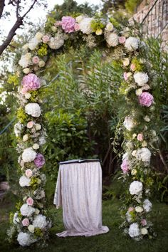 floraled ceremony arch