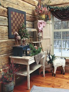 "From our November 2013 issue: In ""Getting Creative,"" a Minnesota couple fill their home with handmade goods for a welcoming vibe that lends itself to storytelling. Visit the homeowner's blog: www.primitivesbymichelle.blogspot.com"