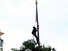Activists take down the Confederate flag at the SC state house. Go ahead asshats. I DARE you to face the wave of coast to coast outrage if you put it back up! LSDuBois
