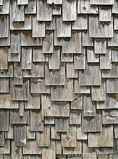 Weathered cedar shingle exterior siding by Jon Byers, via Dreamstime