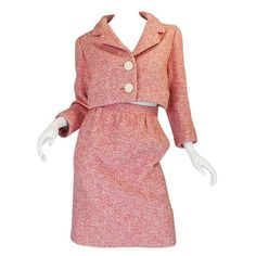 c1963-65 Norman Norell Pink Boucle Cropped Jacket Suit | From a collection of rare vintage suits, outfits and ensembles at https://www.1stdibs.com/fashion/clothing/suits-outfits-ensembles/