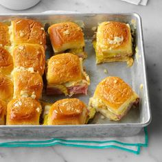 Bake until these wonderful little Cuban sliders are lightly toasted and the cheese melts. The leftover King's Hawaiian ham sliders keep really well in the fridge, and they make a lovely cold snack. Baked Sandwiches, Wrap Sandwiches, Sandwich Recipes, Funeral Sandwiches, Cuban Sandwich, Cuban Sliders, Ham Sliders, Potluck Recipes, Appetizer Recipes