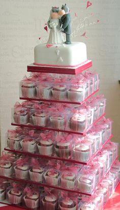 cupcake wedding cake I like how they individually packed