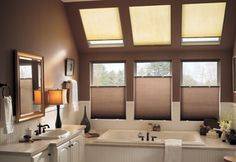 Cover your skylight windows with Bali's most popular cellular shades for a coordinated look with your other windows. Styles include Daybreak II, Northern Lights, Tinted Whites, Libretto and Storm. Skylight Covering, Skylight Shade, Skylight Blinds, Skylight Window, Blinds For Windows, Skylights, High Windows, Bathroom Window Treatments, Bathroom Windows