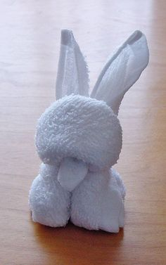 A bunny origami towel. You can see the cute bunny ears popping out from above the head as well as the iconic bunny teeth in front.