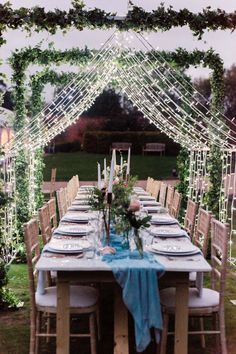 intimate wedding table set up in garden with fairy light canopy over the table. Light Canopy, Canopy Lights, Top Table Ideas, Actress Eva Green, Unique Wedding Stationery, Wedding Details, Wedding Ideas, Fairy Lights Wedding, Ribbon Bouquet