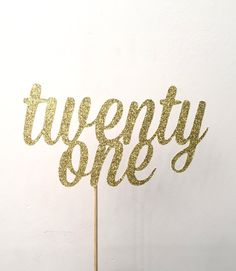 This listing is for one twenty one cake topper. The cake topper is made with a glittery gold cardstock, and is attached with a 5 food safe pick